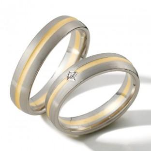 Grau- und Gelbgoldringe mit 1 Princess-Diamanten von Weidner 04327